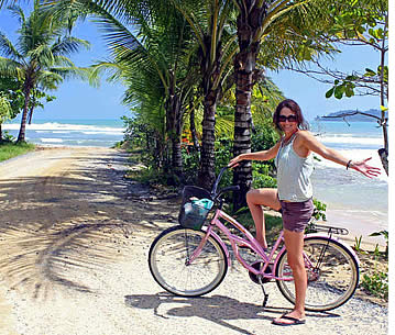Girl cycling to Bluff Beach in Isla Colon, Bocas del Toro